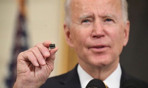 President Biden holding up a semiconductor chip.